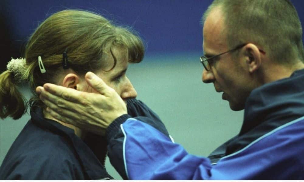 Ao lado do técnico com quem conquistou o bronze no mundial de 2003